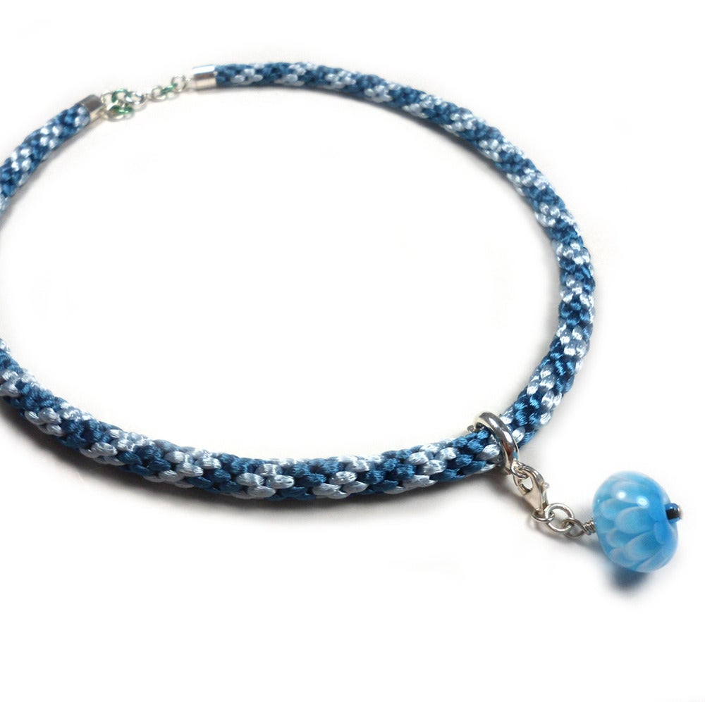 """Image of Blått halskjede med håndlaget glassperle """"krysantemum"""" - braided necklace"""
