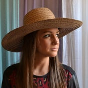 Image of wide brim beach hat