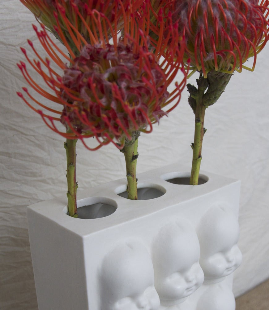 Image of babies everywhere! vase