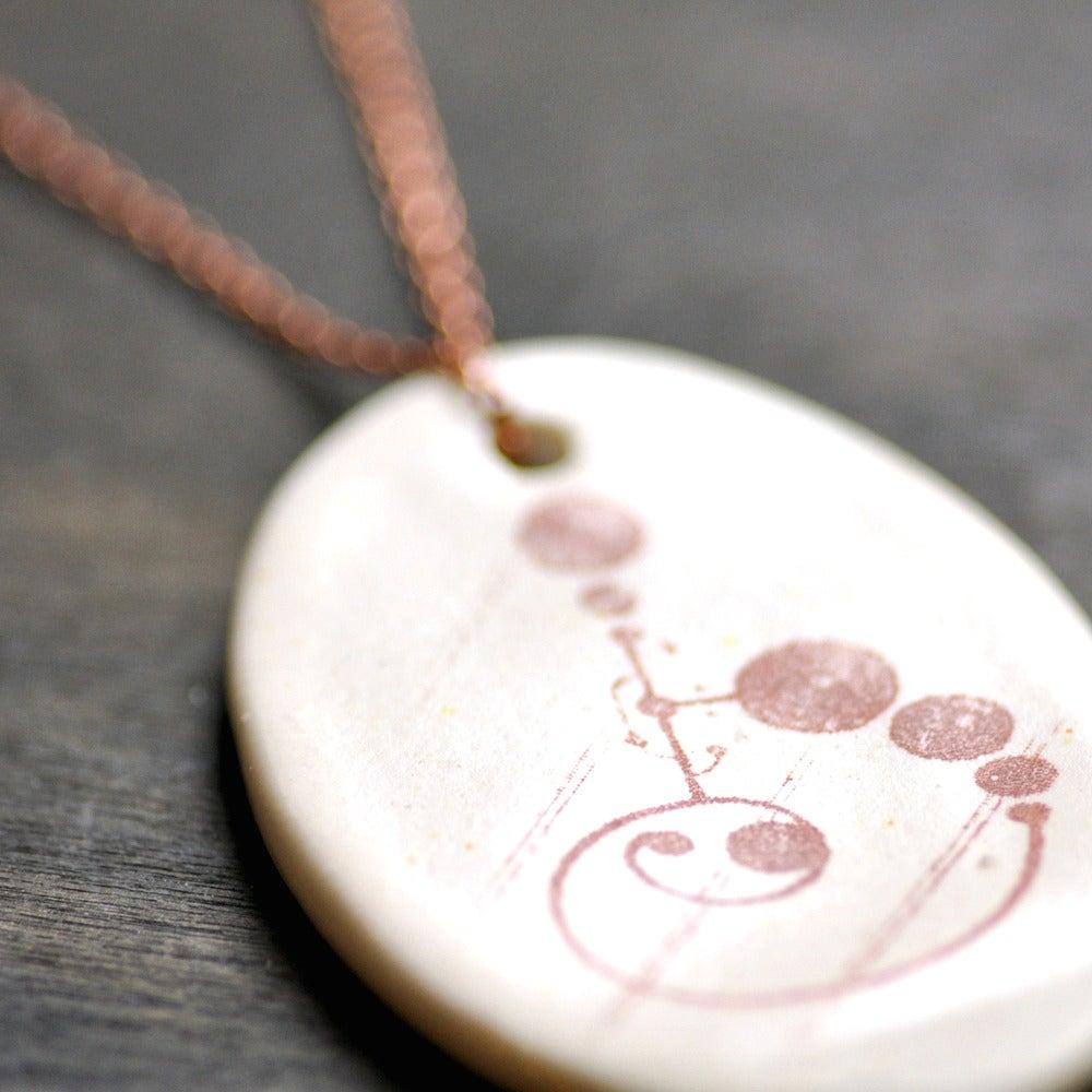 Image of crop circles pendant 2