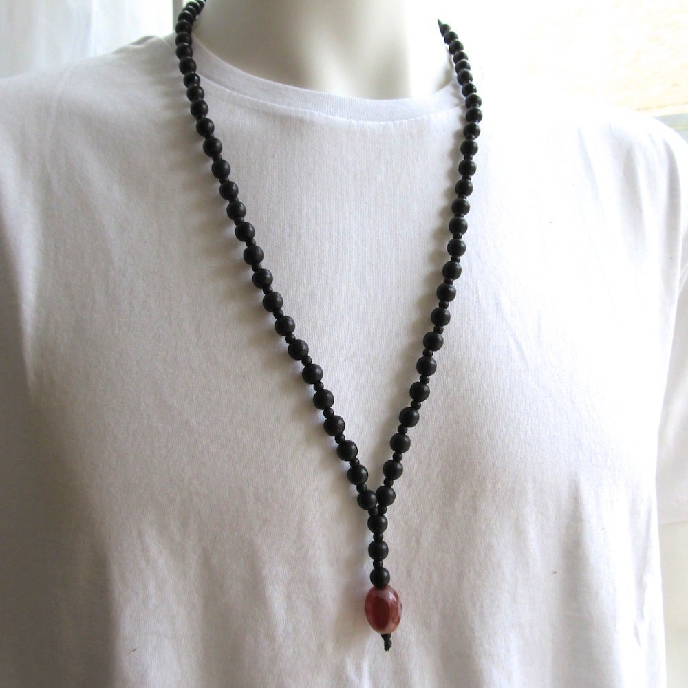 Image of Black Beaded Necklace With Decorative Glass Bead