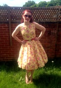 Image of 1950s garden party dress in yellow