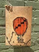 Image of Balloon. Banjo. Bird(on wood)