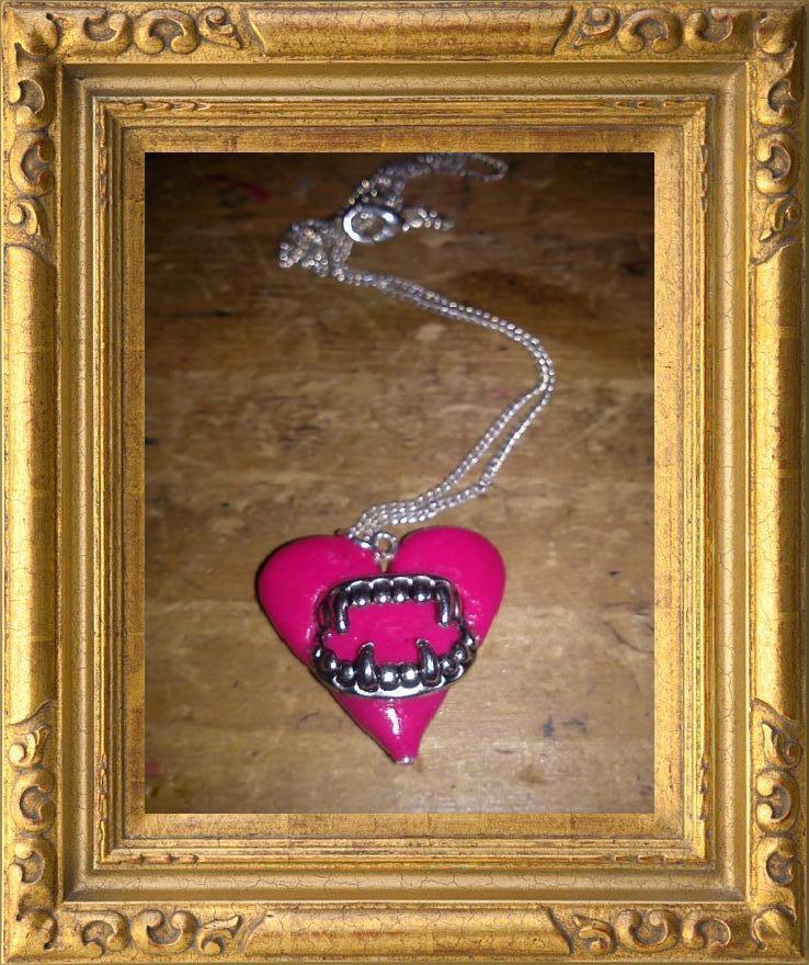 Image of Vampire teeth love heart neclace