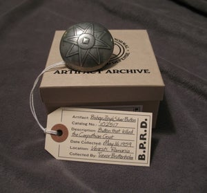 Image of Hellboy/B.P.R.D: Bishop Zrinyi's Silver Button - Signed by Mike Mignola!