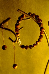 Image of Year of the Tiger Eye stones/sterling silver bracelet $40.00 Earrings $10.00 (sold separately)