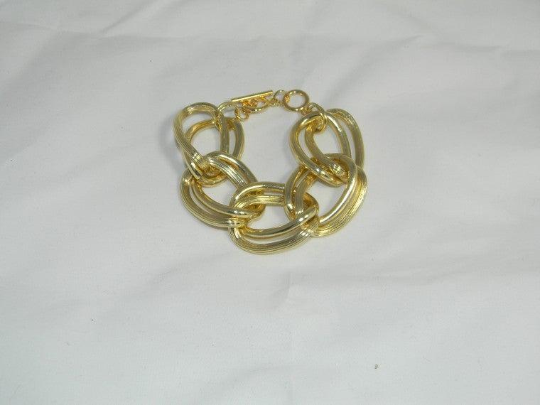 gold big chain bracelet compliments accessories