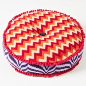 Image of Orange 'Wave' round cushion