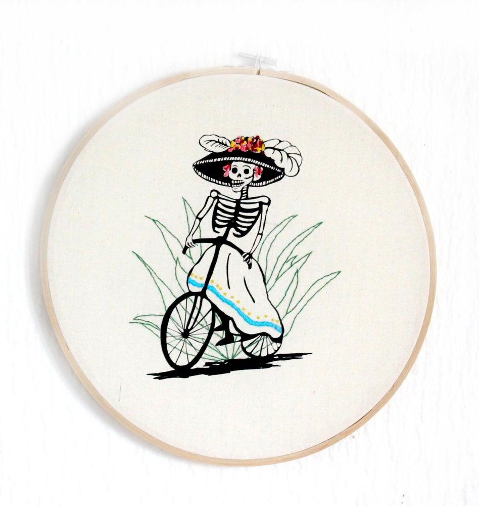 Image of Catrina en bicicleta