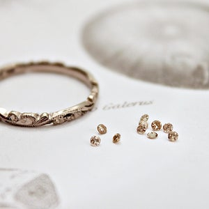 Image of 1.5mm brilliant~cut champagne diamond