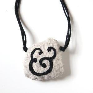 Image of & - italic ampersand pendant