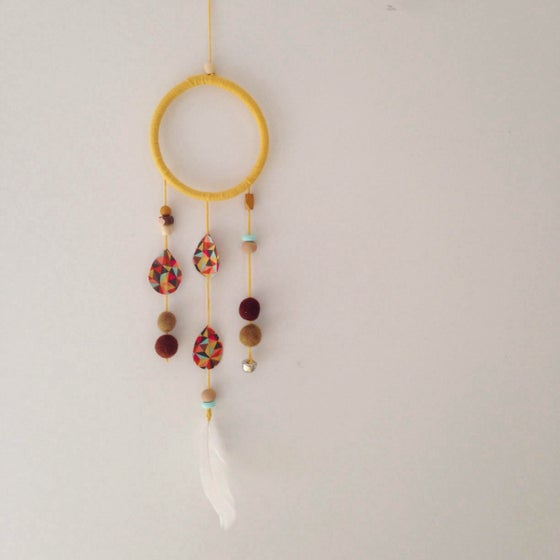 Image of yellow dream catcher wall hanging