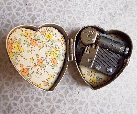 Image of Tiny Music Box Locket (Sepia) - choose your tune
