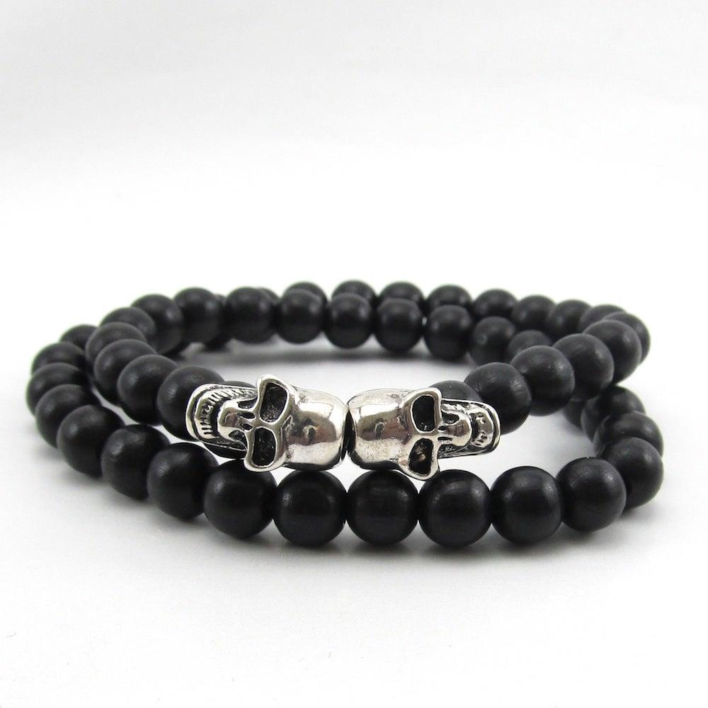 Image of Black beaded double skull double wrap bracelet