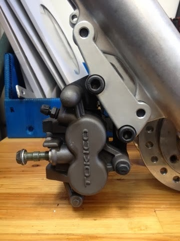 Image of '84-99 Narrow Glide Caliper Adapter