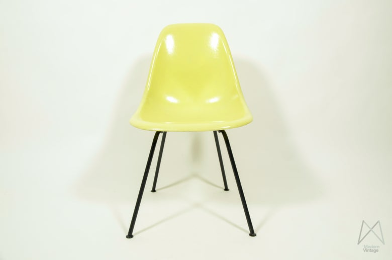 Image of Eames Herman Miller Lemon Yellow fiberglass chair