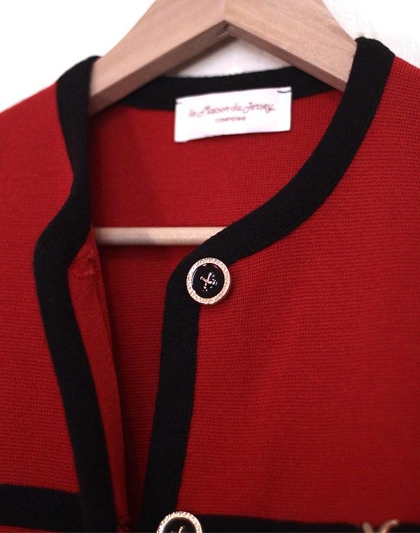 Image of Veste en laine rouge et noire