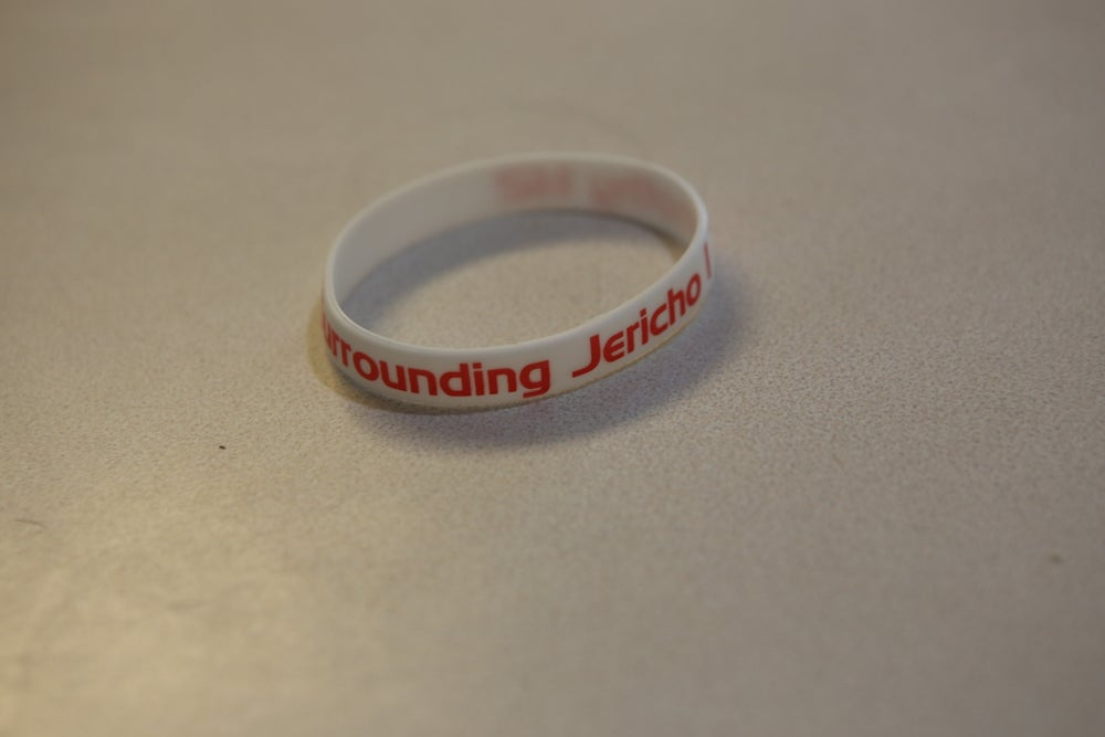 Image of White w/Red lettering wristband