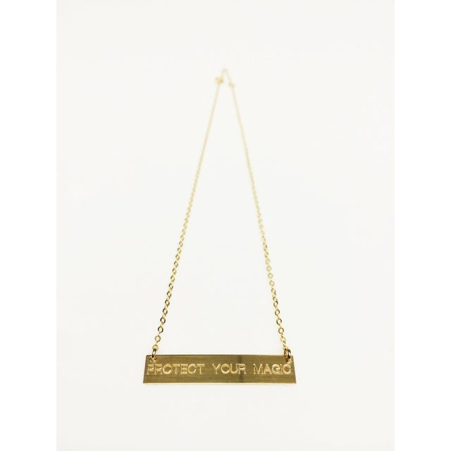 pym 14k gold bar necklace engraved protect your magic