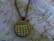 Image of Yellow Calendar Necklace