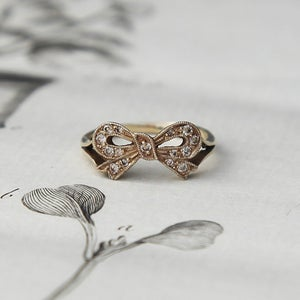 Image of 9ct gold champagne diamond set bow ring