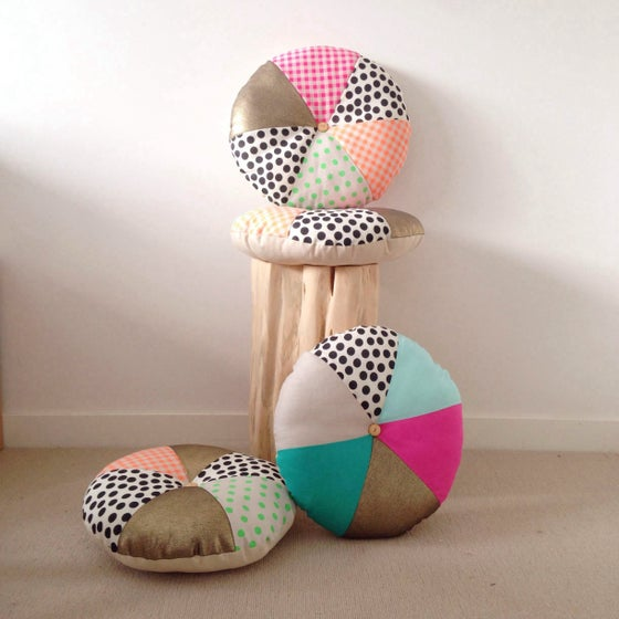 Image of Round patchwork cushion