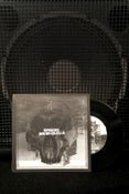 "Image of split w/ of feather and bone (7"" record)"