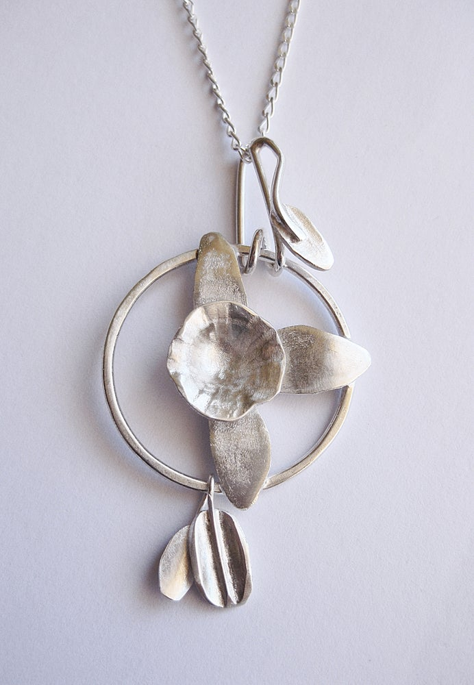 Image of Daffodil orchid specimen pendant: in forged sterling silver