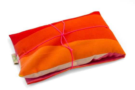 Image of Heat pillow - orange geo
