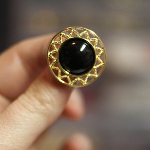 Image of Gold Fancy Black Center Plugs (sizes 9/16-1 1/8)