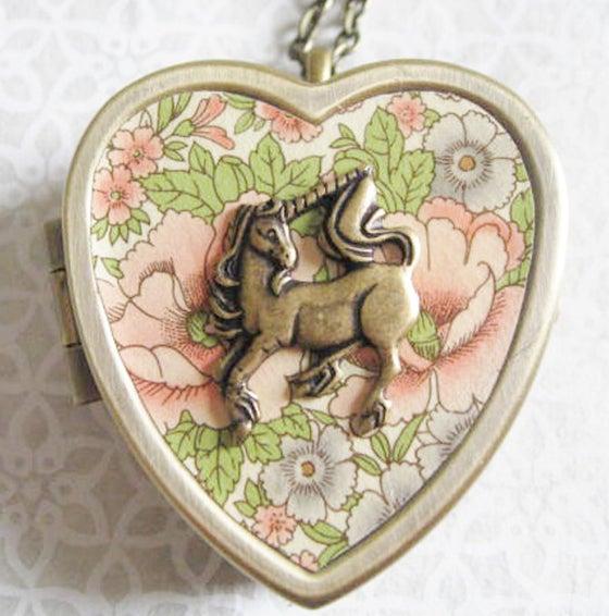 Image of Little Unicorn Music Box Locket - bronze and rose