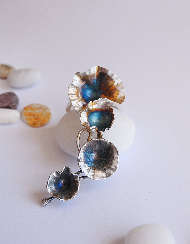Image of Trailing daisy ring forged in sterling silver with rainbow patina
