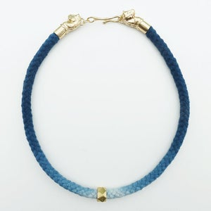 Image of Brass Horse Necklace with Blue and White Cord and Brass Bead