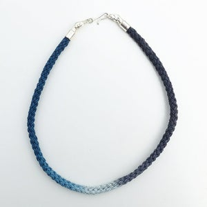 Image of Silver Dog Necklace with Blue, Black and White Cord