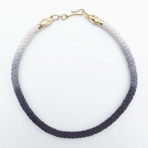 Image of Brass Swan Necklace with Gray and White Cord
