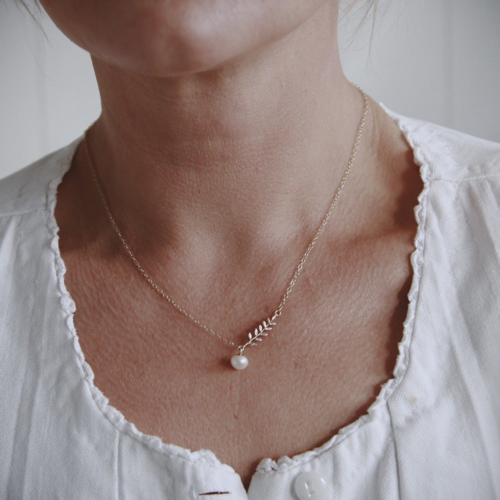 Image of gold fern leaf and pearl necklace