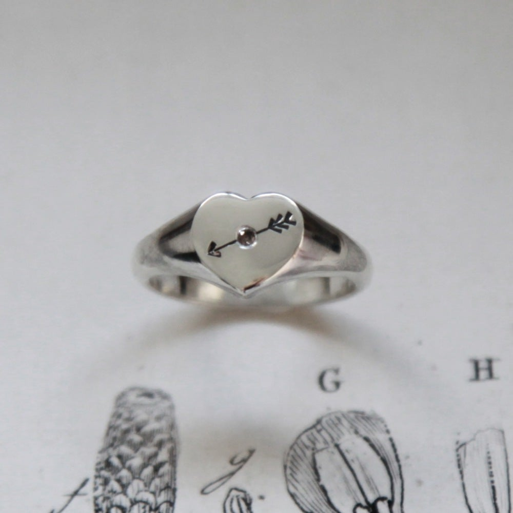 Image of heart arrow signet ring with diamond