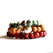 Image of Flameball pearl acai seed stacking bracelet set