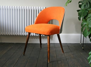 Image of 1950's occasional chair in orange