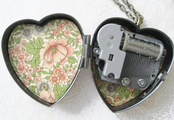 Image of Sweet Molly Cat Face Musical Locket - bronze and rose