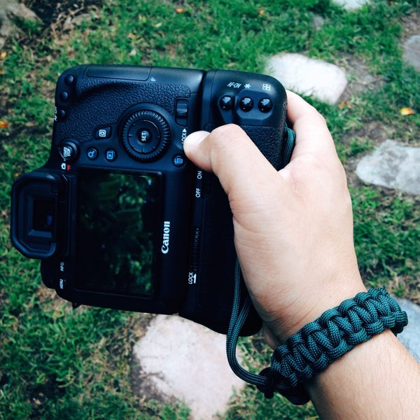 Image of Hunter green adjustable camera wrist strap
