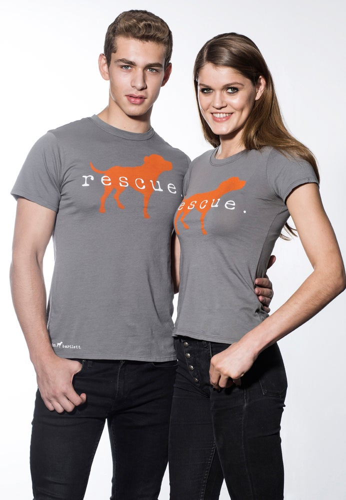 "Image of slim-fit girl's premium ""rescue"" tee. cement grey with orange dog logo."