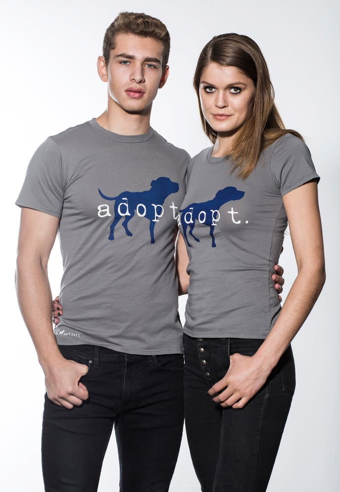 "Image of slim fit guy's premium ""adopt"" tee. cement grey body with navy dog logo"