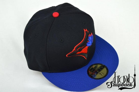 Image of TORONTO BLUE JAYS CUSTOM RETRO BLACK, BLUE & RED NEW ERA 59FIFTY FITTED CAP