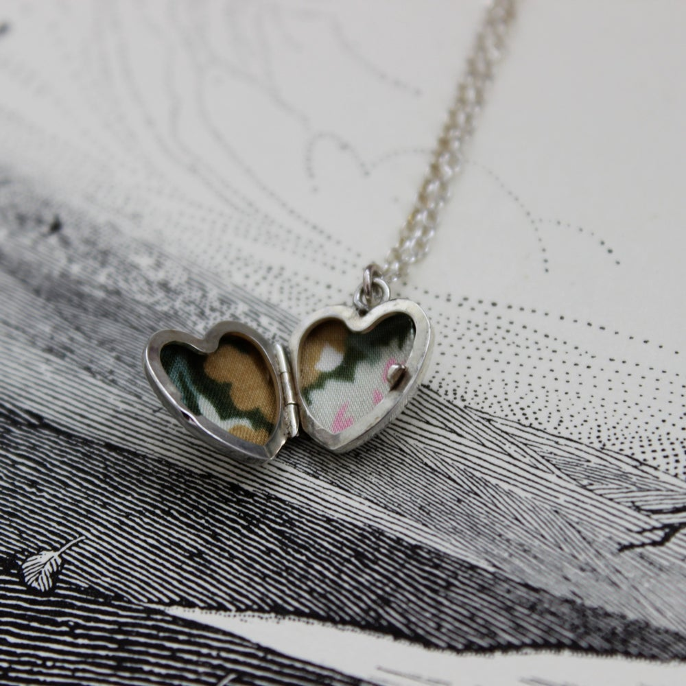 Image of little arrow heart locket