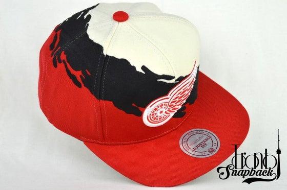Image of DETROIT REDWINGS CREAM/BLACK/RED MITCHELL & NESS SPLASH SNAPBACK CAP