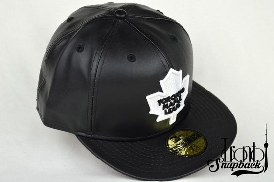 Image of TORONTO MAPLE LEAFS CUSTOM BLK/WHT LEATHER NEW ERA FITTED HAT