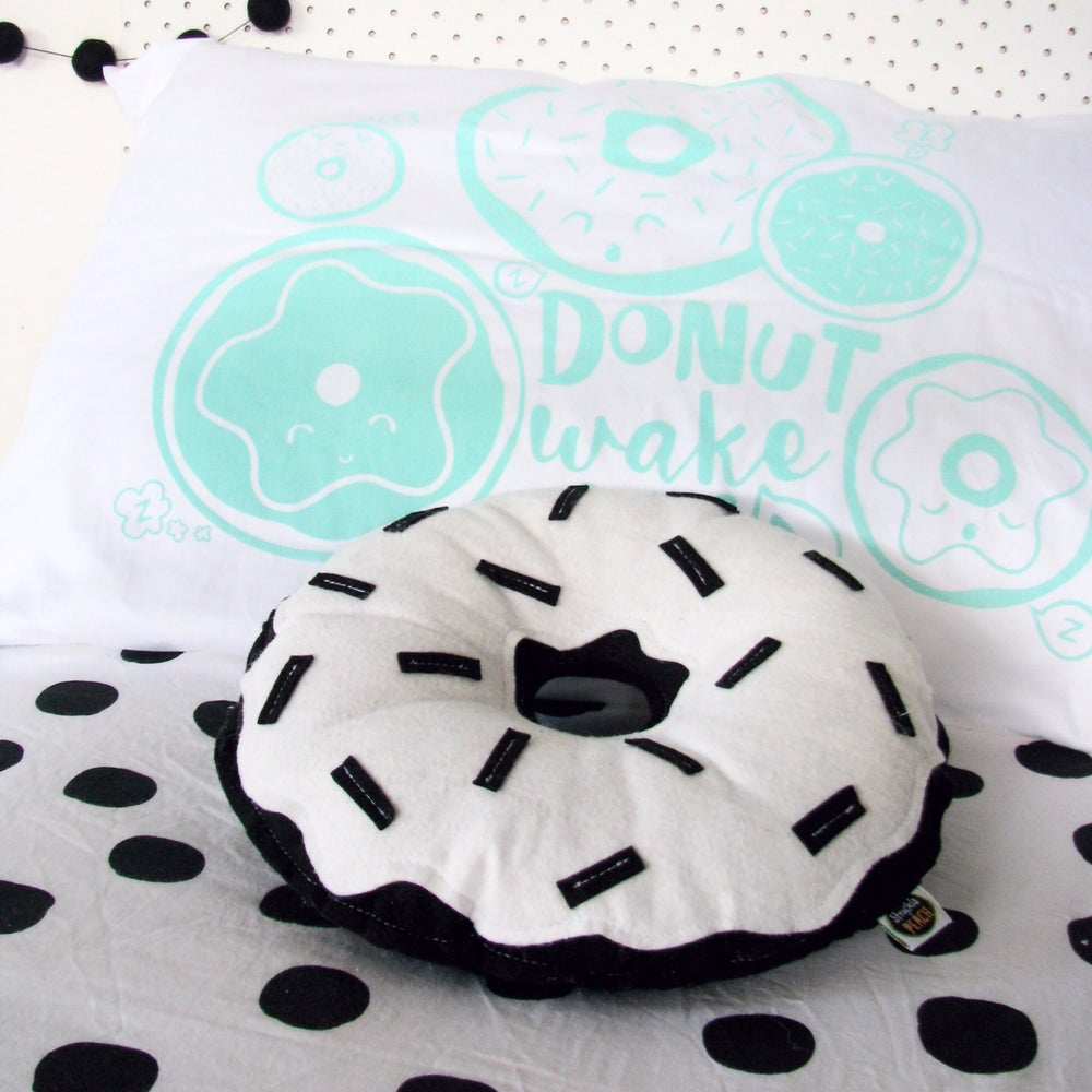 Image of COLOUR DONUTS - BLACK WITH WHITE FROSTING