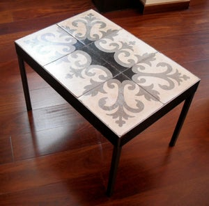 Image of Black fleur-de-lis coffee table