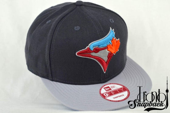 Image of TORONTO BLUEJAYS AIR JORDAN 7 BARCELONA NEW ERA SNAPBACK CAP